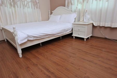 modern bedroom with a double bed.   photo