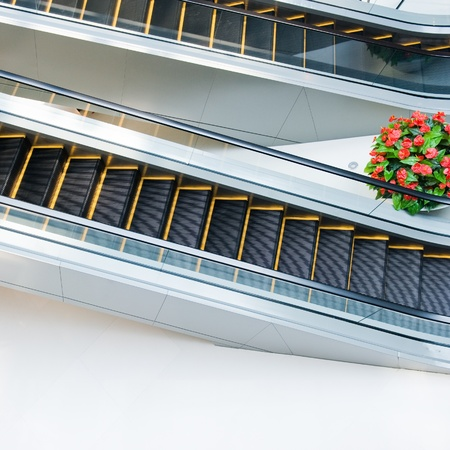 view of a staircase in a shop: escalator in modern building interior .  Stock Photo