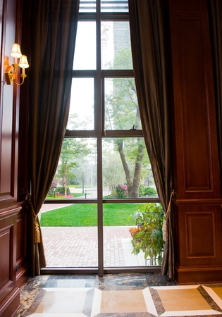 Window and curtains with  garden view in the middle. Stock Photo - 13236891