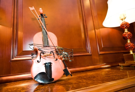 A violin on the cabinet, taken at home. photo