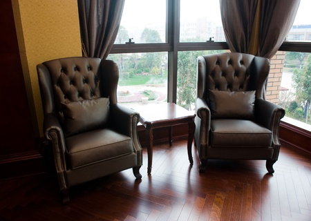 Two chairs and table in classic living room.  photo