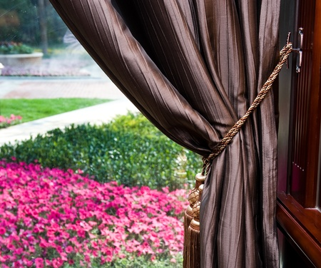 Elegant curtain and window in a garden Stock Photo - 13236861