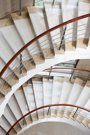 elegant staircase: A marble, spiral staircase in the fashionable hotel.