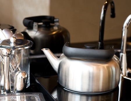 stainless steel range: Electric range and oven with the kitchenware Stock Photo