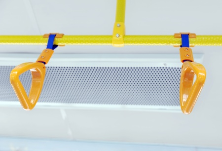 gripping bars: Handles for standing passenger inside a bus. Stock Photo