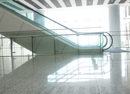 shiny floor: A escalator for transportation going up or down.  Editorial