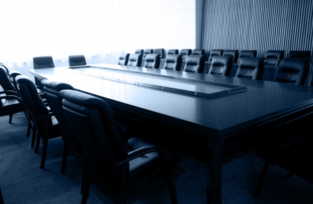 boardroom: Conference table and chairs in meeting room   Editorial