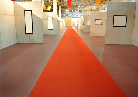 red carpet in a gallery interior.