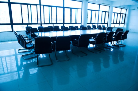 Boardroom meeting: Empty business conference room interior.