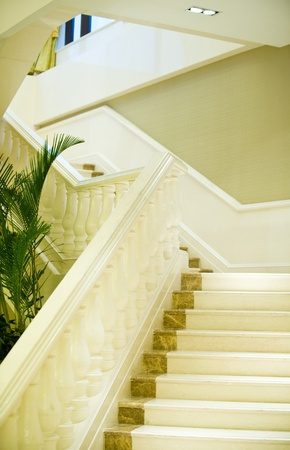 white marble stairs and handrail in a luxury building.