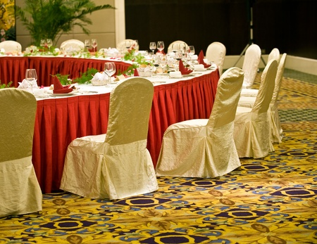 Round banquet table with chairs in chinese hotel.