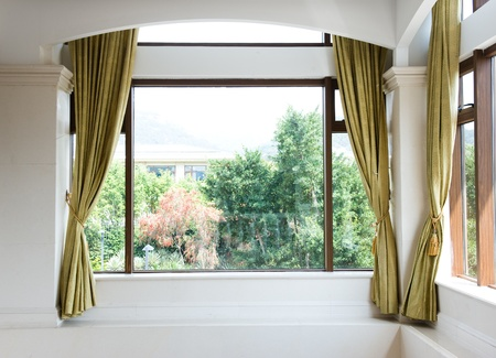 window pane: Window and curtains with  garden view .