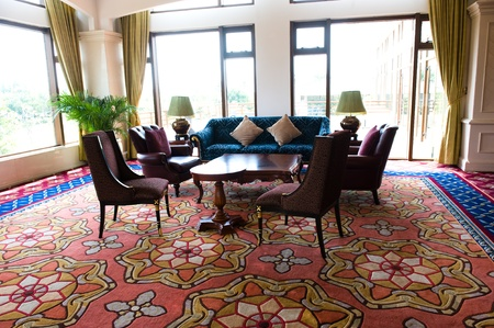 Lobby interior of a hotel with sofa and armchairs.