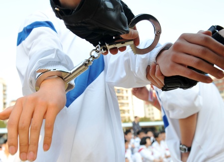 Police law steel handcuffs arrest crime human hand