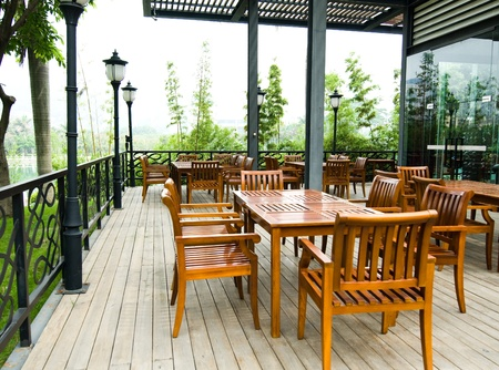 House patio with wooden patio furniture