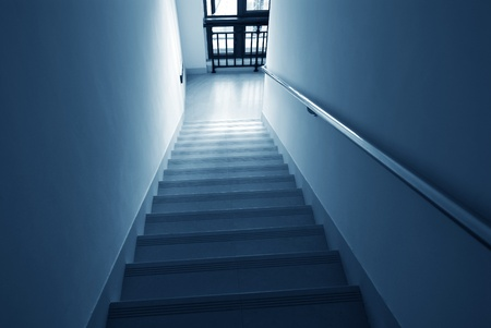building on fire: Staircase with light fire exit of a building.