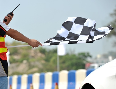 checker: checkered race flag in hand.