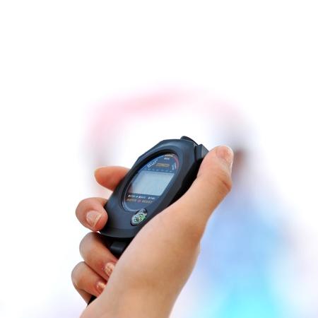 chronometer: Running stopwatch in the hand Stock Photo