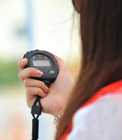 Correr cron�metro en la mano Foto de archivo - 13344617