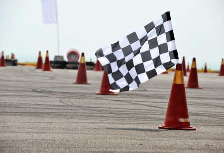 chequer: checkered race flag standing on floor. Stock Photo