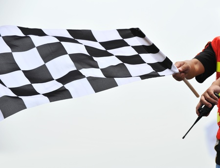 starting: checkered race flag in hand.