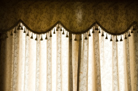 Picture of luxurious curtains at home.  photo
