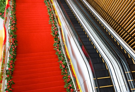 Red carpet on the steps leading to the doorway.  photo