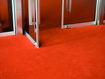 glass doors: Red Carpet entrance for a celebrity welcome  Stock Photo