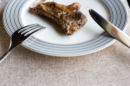 Image of lamb chops in fork. photo