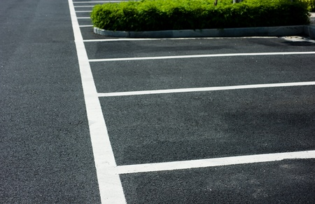new car lot: Empty parking spaces await commuters. Stock Photo