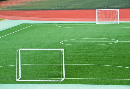 sporting: Empty soccer field with goal posts and light poles. Stock Photo