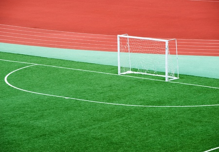 goalpost: Empty soccer field with goal posts and light poles. Stock Photo