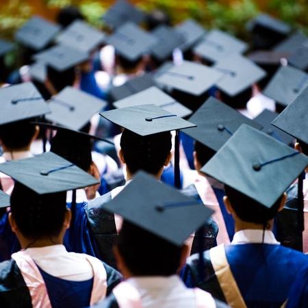 commencement: Shot of graduation caps during commencement.