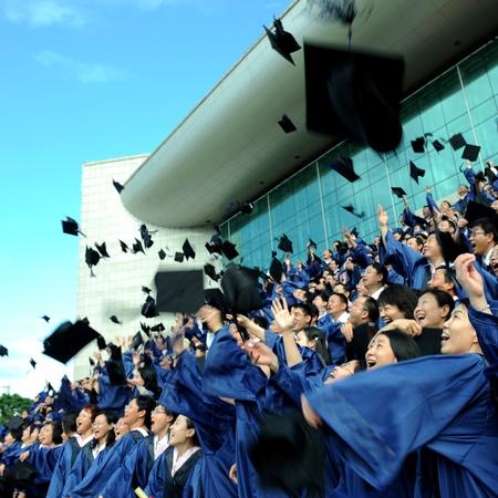 commencement: high school graduation hats high  Editorial