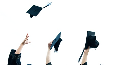 masters degree: high school graduation hats high  Stock Photo