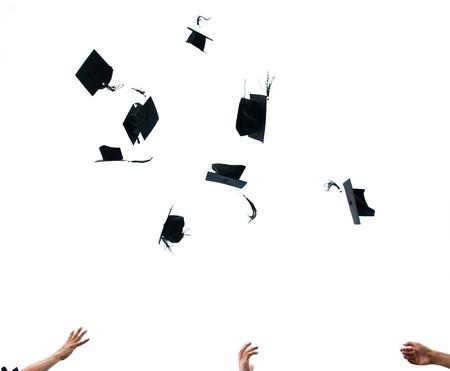 graduating seniors: high school graduation hats high  Stock Photo