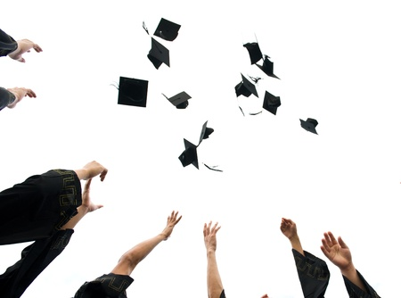finishing school: high school graduation hats high  Stock Photo