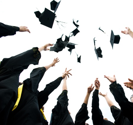 college graduate: high school graduation hats high  Stock Photo