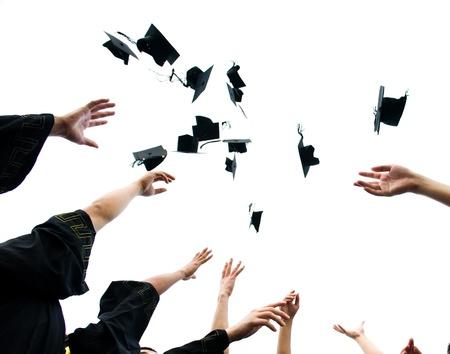 altos sombreros de graduación de secundaria Foto de archivo