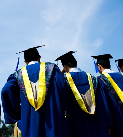 mba: back of chinese graduates with blue sky  Stock Photo