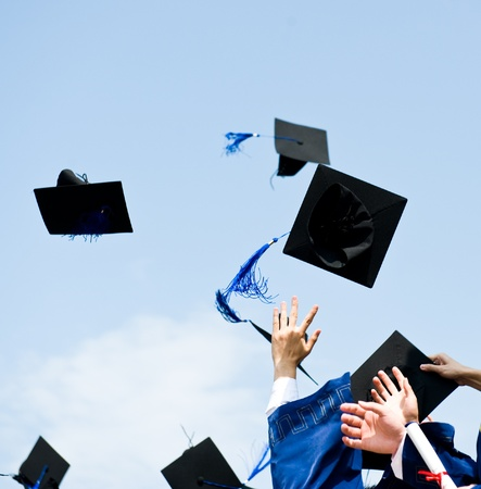 cap and gown: high school graduation hats high  Stock Photo