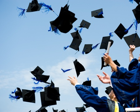 graduate hat: high school graduation hats high  Stock Photo