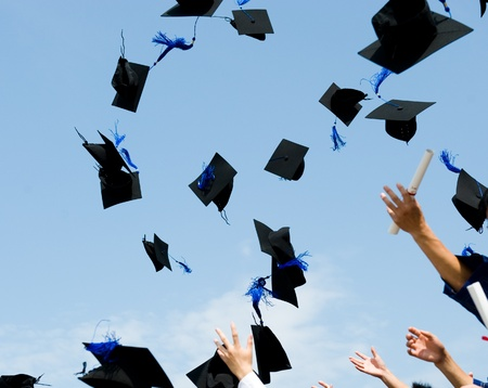 college graduation: high school graduation hats high  Stock Photo