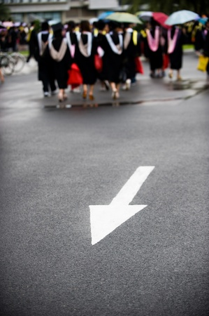 commencement: group of graduates on the road.