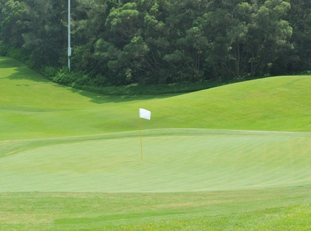 White flag on golf course  Stock Photo - 13448115