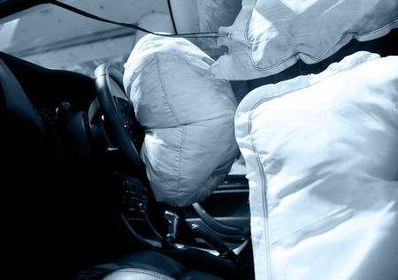airbag: Air bag deployed after car wreck aftermath.