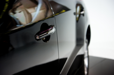 glans: Dörr bil - specificera lyxbil Stockfoto