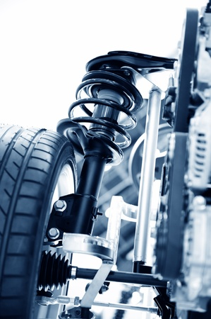 race car shock absorber and wheel. Stock Photo - 13448213