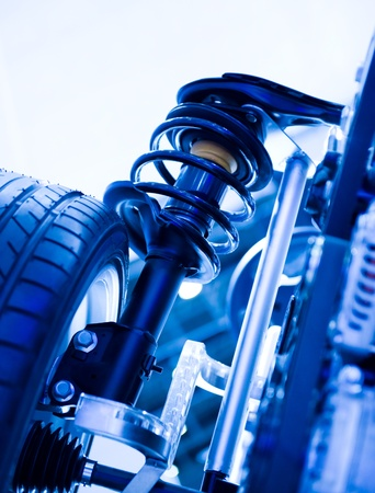 absorber: race car shock absorber and wheel.