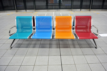 colored metal bench in a subway station.  photo